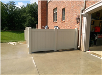 Fence Gallery Photo - 4 ' high PVC with plate mount to driveway.jpg