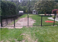 Fence Gallery Photo - Custom Gate with sloping bottom.jpg