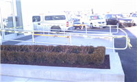 Fence Gallery Photo - Aluminum Pipe Rail at Car Ramp.jpg