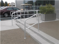Fence Gallery Photo - Aluminum Pipe Rail at Step for a Car Dealership.jpg
