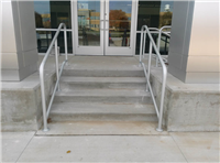 Fence Gallery Photo - Aluminum Stair Rail at Car Dealership.jpg